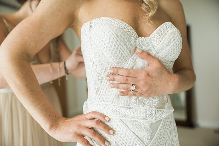 The bride was wearing an amazing boho lace strapless mermaid wedding dress by Rue De Seine