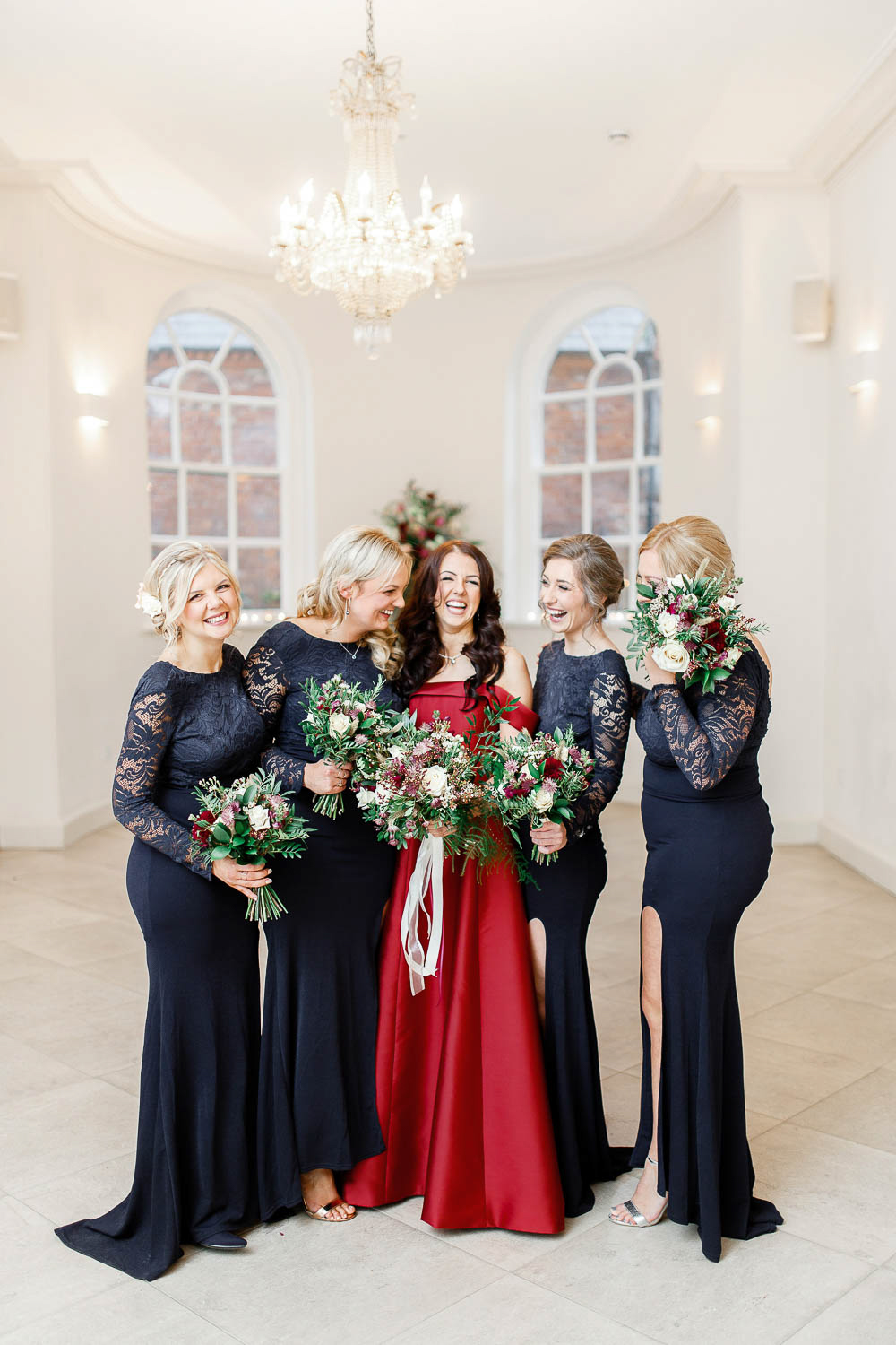 The bridesmaids were wearing navy maxi dresses with lace bodices and sleeves and side slits