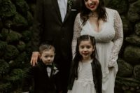 03 The groom and their son chose black tuxedos and the daughter was rocking a white dress and a dark cardigan