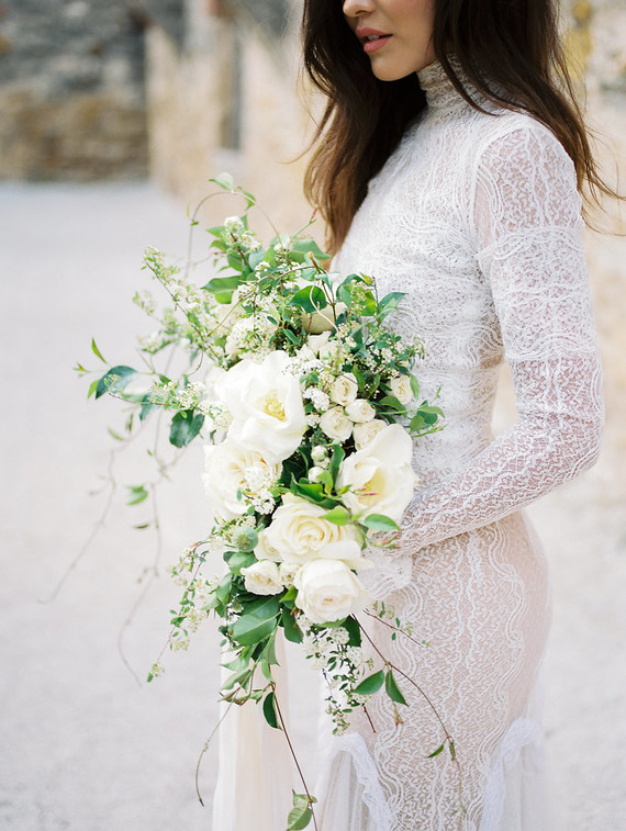 The wedding bouquet was done with neutral blooms and lush and textural greenery