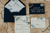 03 The wedding stationery was done with black envelopes and watercolor grey and blue with calligraphy and lunar motifs
