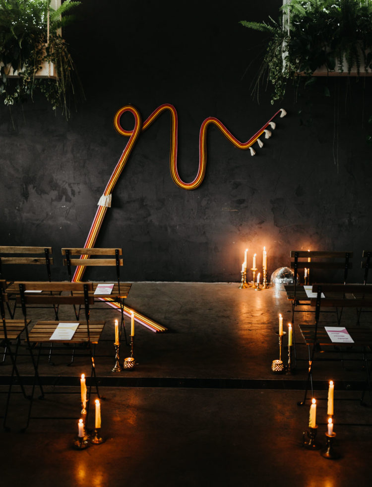 What a nice ceremony space with neon touches, a disco ball and candles