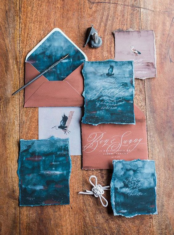 a gorgeous coastal wedding invitation suite in rust and teal with a deckle edge