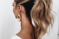 03 a high ponytail with a bump on top and textural hair is a great ultra-modern idea