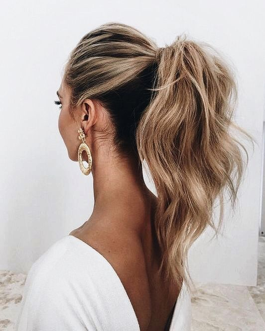 a high ponytail with a bump on top and textural hair is a great ultra-modern idea