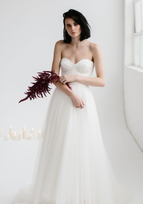 a strapless A-line wedding gown with a lace bodice and an A-line  skirt for a modern romantic bride