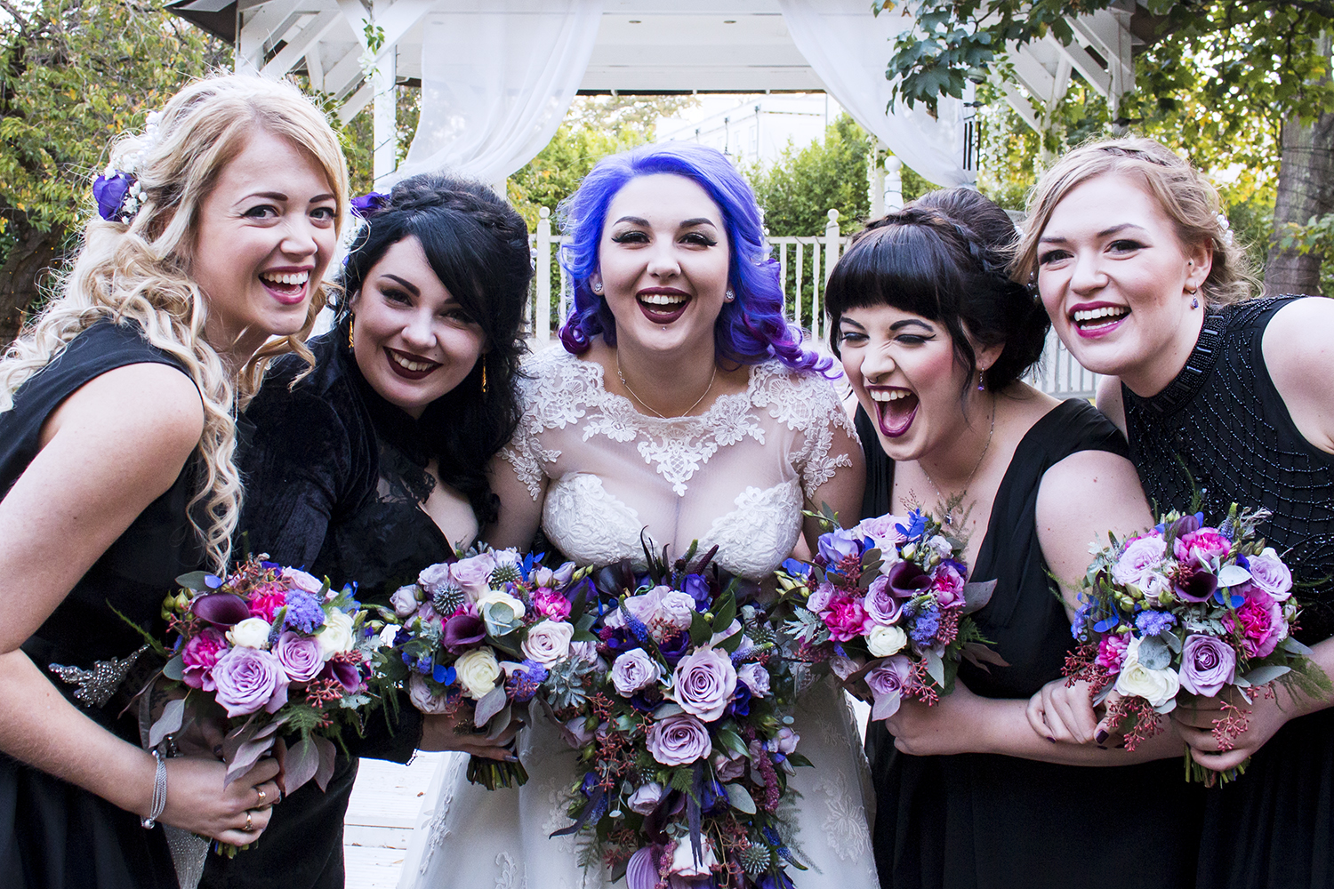 Her bridesmaids were wearing mismatching black dresses of their choice