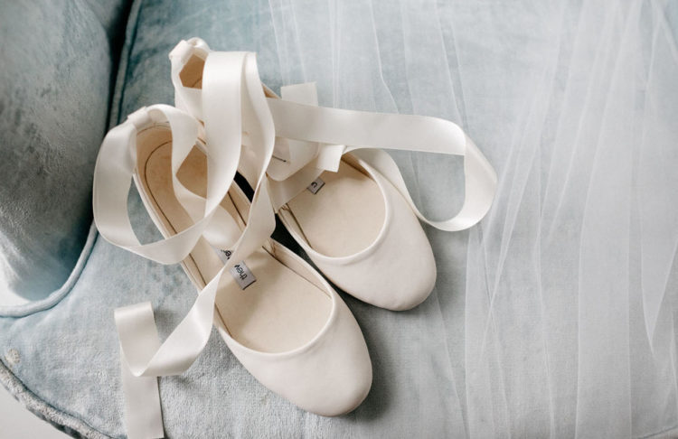 The bride chose ballet flats to pair with her vintage dress
