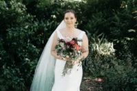 04 The bride was wearing a plain fit and flare wedding gown with a deep neckline and a gorgeous blue ombre veil