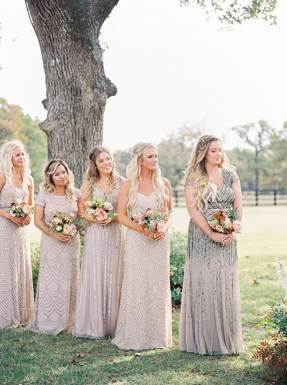 The bridesmaids were wearing embellished dresses in blush and grey