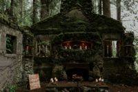 04 The wedding altar was a gorgeous one, with an antique hearth covered with moss and decorated with candles all around
