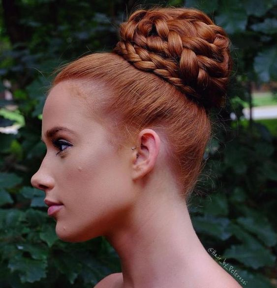a fully braided top knot is a cool take on a traditional top knot and braids are veyr trendy
