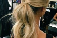 04 a simple and cute low ponytail with waves, locks down and a bump on top