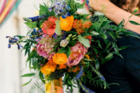 05 The bridal bouquet was a bold one, with blooms of different shades and colorful ribbons