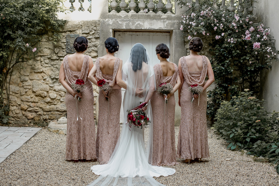 The bridesmaids were rocking blush pink dresses with delicate beding and a cowl back
