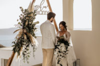 05 The ceremony space was done with a triangle arch, pampas grass and greneery,faux fur and lanterns