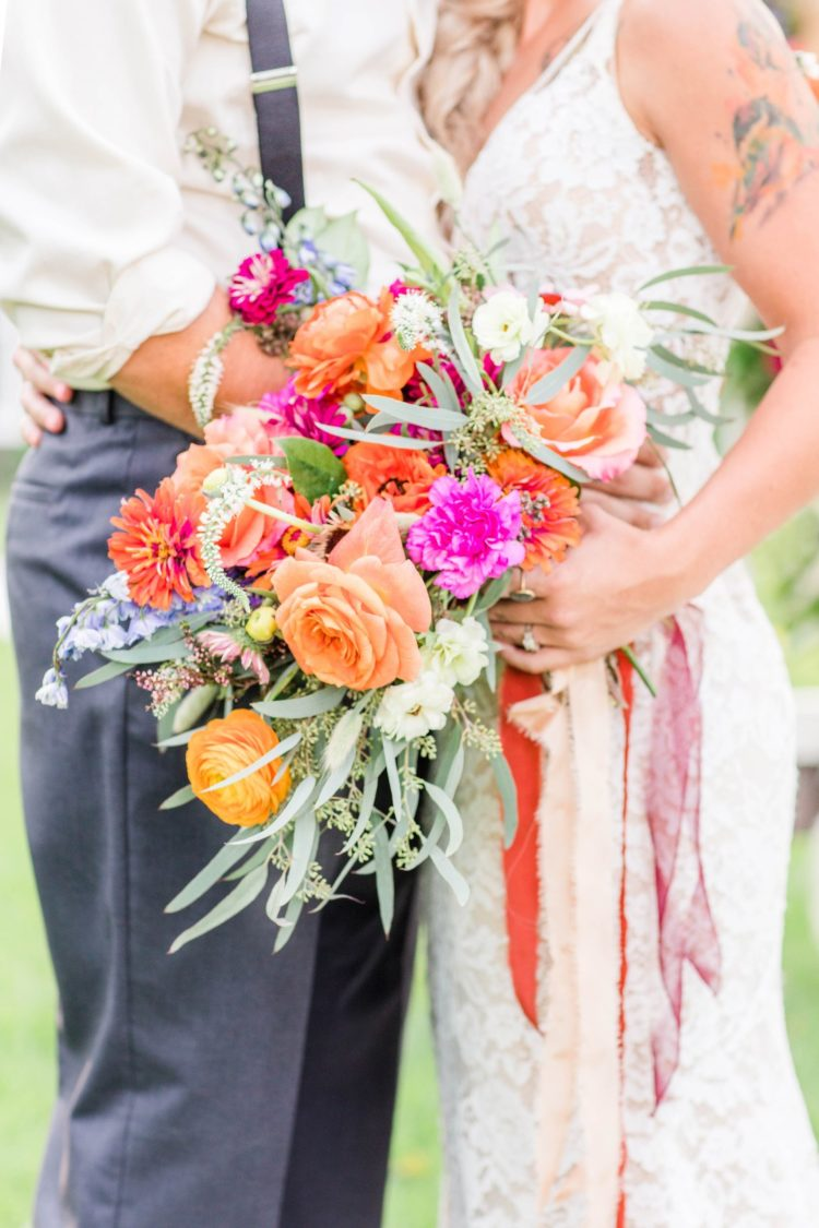 The wedding bouquet was done with pink, purple, orange, yellow blooms and textural greenery