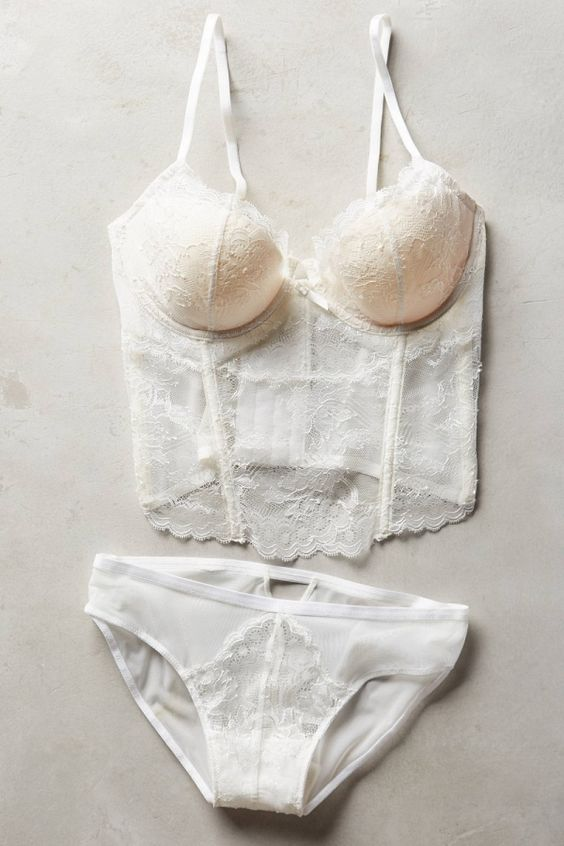 a chic white Chantilly lace bridal lingerie set with a bustier and panties with sheer parts