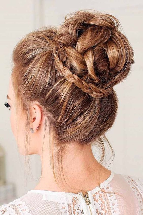 a gorgeous braided top knot with a little braid for detailing and some locks down is a bold idea