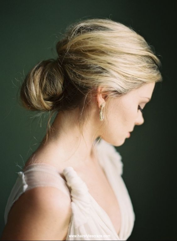 a messy and textural low bun with a large bump is a sophisticated idea to make your look wow