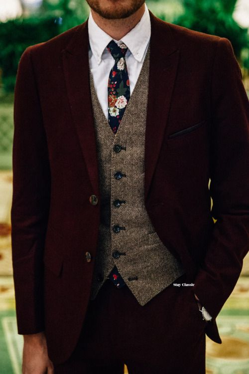 a vintage look with a burgundy velvet suit, a beige tweed waistcoat and a moody floral tie