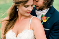 06 The bride was wearing statement earrings, and the groom rocked a trendy hairstyle
