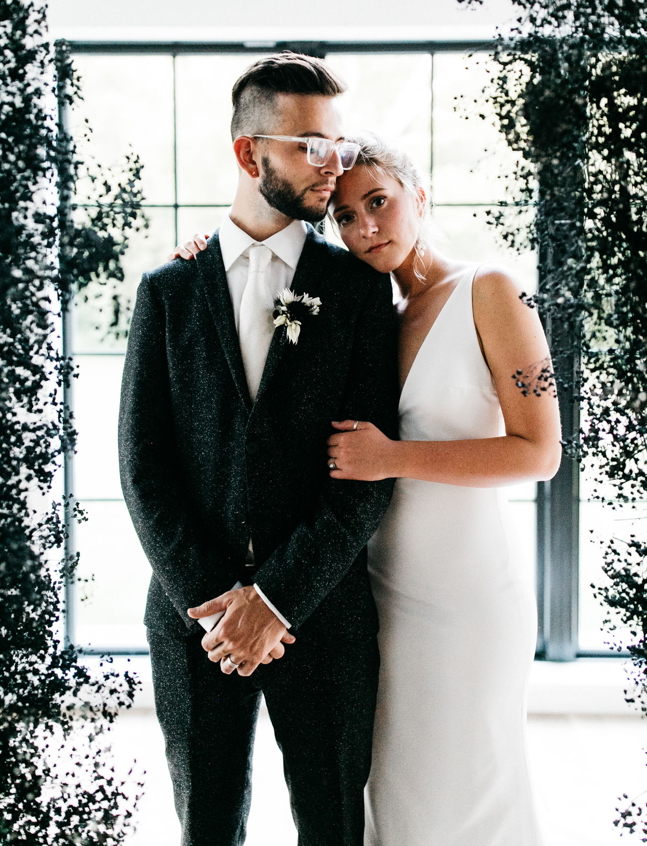 Picture Of The Groom Was Wearing A Black Speckled Suit A White