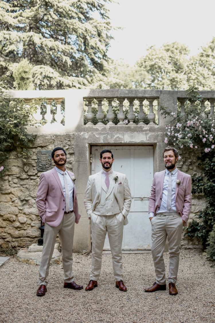 The groomsmen were wearing a color palette of ivory and pale candy pink