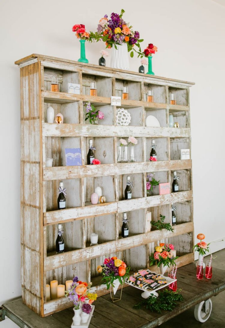 The wedding bar was styled with a shabby chic storage unit with glasses and little bottles