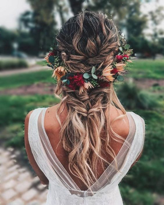 a half updo with braids and twists plus some locks down and a bright floral halo
