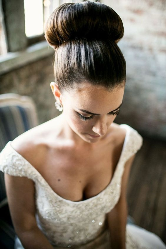 a large ballerina bun is classics, which is ideal for a formal wedding in any venue