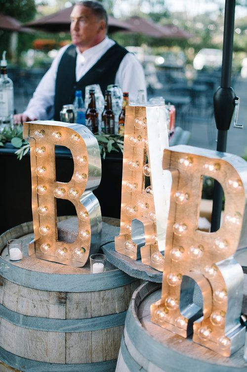add marquee lights of your choice to spruce up the wedding bar decor