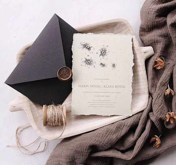 deckled edge natural wedding invitations with a handmade envelope and a bronze wax seal