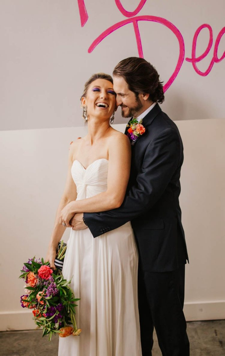 The bride was wearign a draped strapless wedding dress and statement earrings