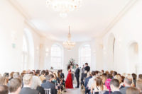 07 The ceremony space was all-white, with glam chandeliers and a large floral decoration