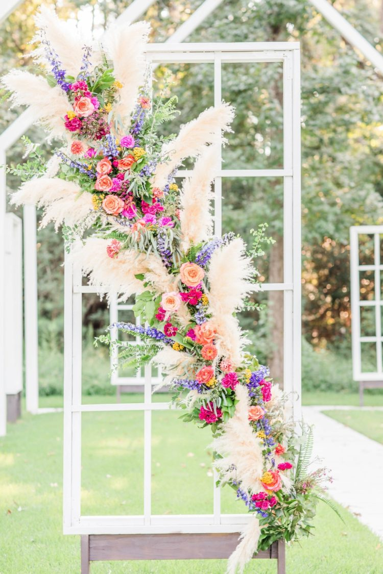 The chapel was also decorated with super bright blooms, greenery and pampas grass