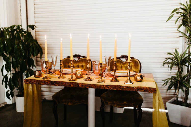 The sweetheart table was done with lots of gold touches and refined plates