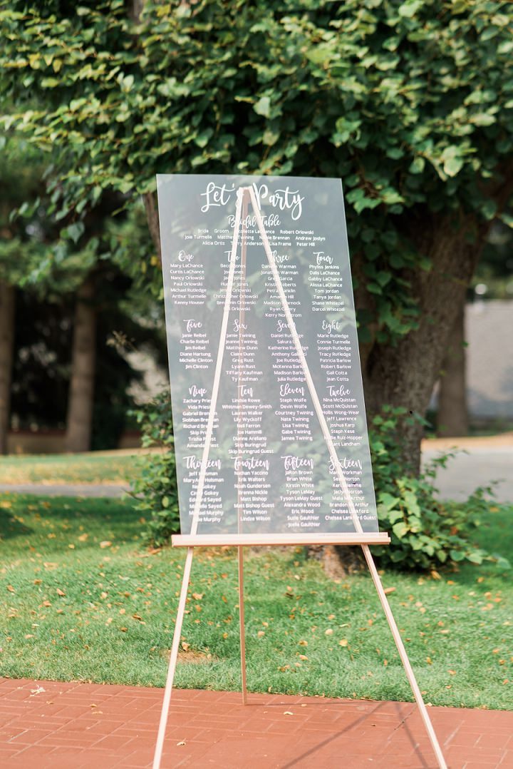 The wedding seating chart was an acrylic one with calligraphy