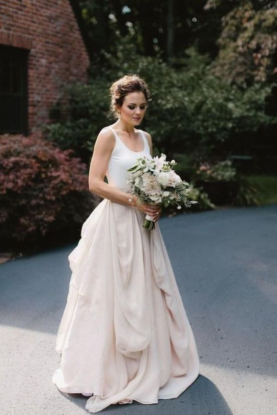 a chic bridal separate with a blush draped maxi skirt and a white top for a relaxed look