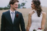 07 a navy two-piece wedding suit with a light grey tie and a burgundy floral boutonniere