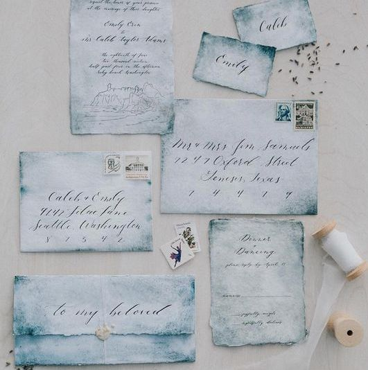 chic watercolor blue wedding invitation suite with a deckle edge for a coastal wedding