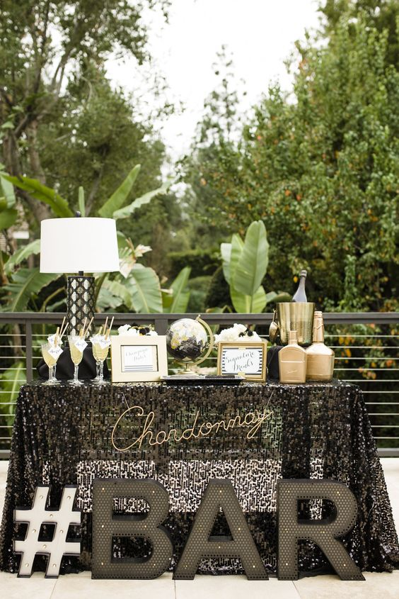 large marquee letters, gilded touches and globes for a tropical travel-themed wedding