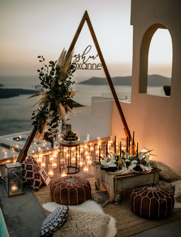 The picnic was overlooking the ocean, filled with candle light, boho rugs, Moroccan ottomans and greenery