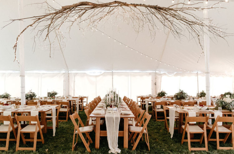 The reception took place in a tent, there was a large branch chandelier with lots of lights