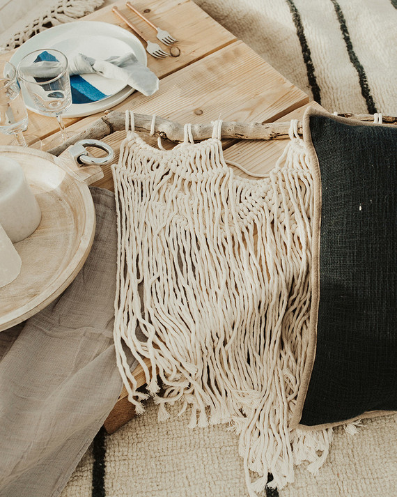 The wedding picnic was styled with macrame and simple textiles