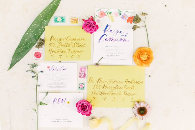The wedding stationery was colorful, with calligraphy and handpainted florals