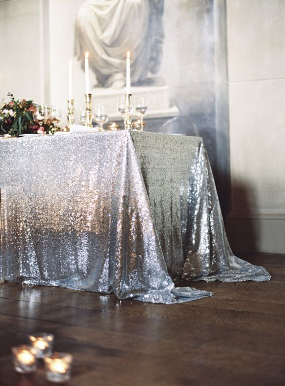 a chic silver sequin tablecloth and gold accents for a glam wedding table setting