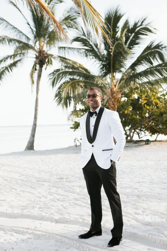 a glam formal look with a white tux with black detailing and black moccasins