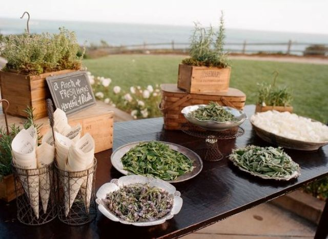 a toss bar - a table with herbs and petals in bowls and plates, let your guests choose