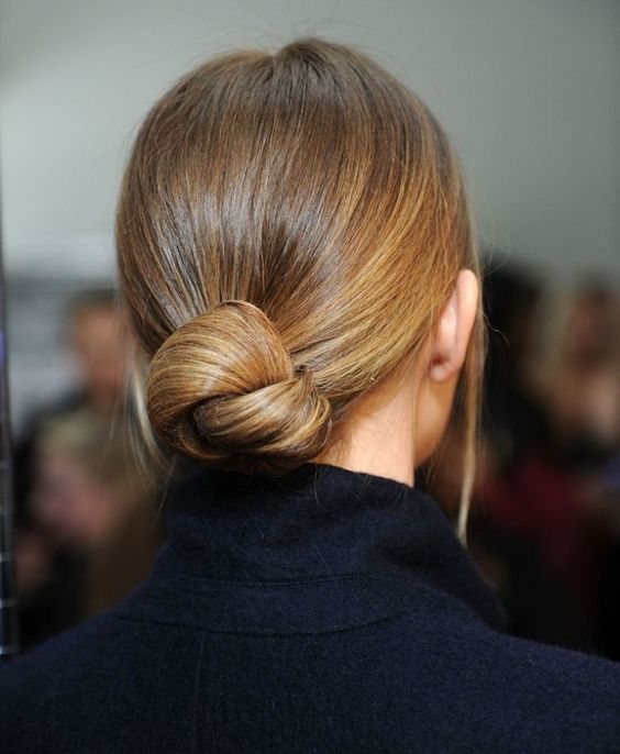 a very sleek twisted low bun with no hairpieces for a chic ultra minimalist bridal look